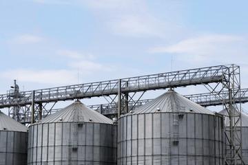 Elevators for storage of grain stocks against the blue sky