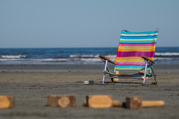 A colorful chair at the beach