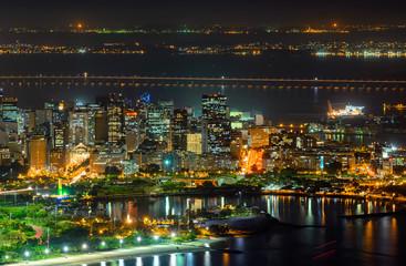 Night aerial view of Centro (downtown of Rio de Janeiro), Flamengo, Gloria and Guanabara bay Rio de Janeiro, Brazil.