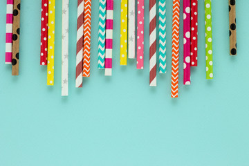Colorful background with multicolored drinking paper straws for cocktails.