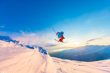 Wall Mural - good skiing in the snowy mountains, Carpathians, Ukraine, a beautiful winter sunset, incredible ski jump