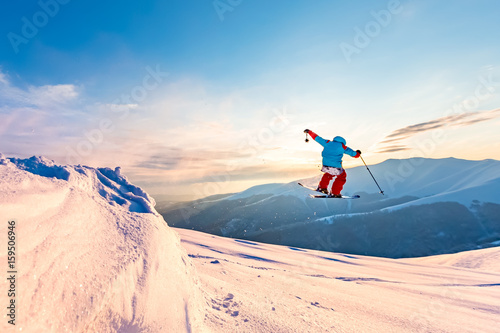 Wall mural good skiing in the snowy mountains, Carpathians, Ukraine, a beautiful winter sunset, incredible ski jump