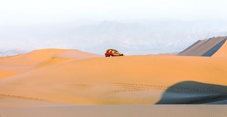 Tourists travel through the dunes in the Atacama Desert - Oasis of Huacachina, Peru, South America.