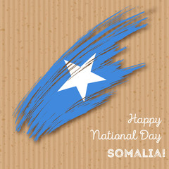 Somalia Independence Day Patriotic Design. Expressive Brush Stroke in National Flag Colors on kraft paper background. Happy Independence Day Somalia Vector Greeting Card.