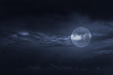 Blue overcast full moon night
