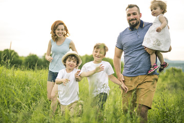 Happy family in the meadow