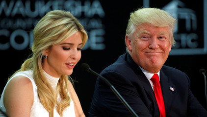 U.S. President Donald Trump listens to his daughter Ivanka speak during a visit to Waukesha County Technical College in Pewaukee