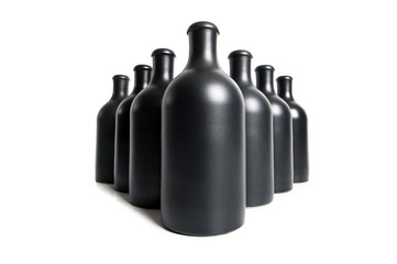 Matte black bottles on a white background close-up..