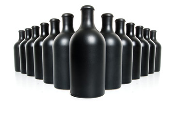Set of black clay bottles on a white background..
