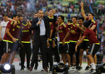 Venezuela's head coach Rafael Dudamel celebrates next to players during the welcoming ceremony of Venezuela's under-20 soccer team, upon their arrival from the FIFA U-20 World Cup in Caracas