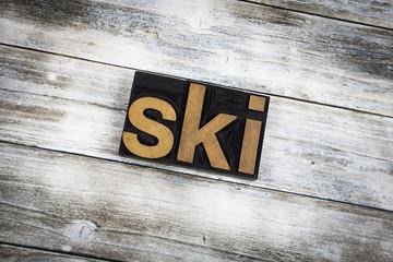 Ski Letterpress Word on Wooden Background