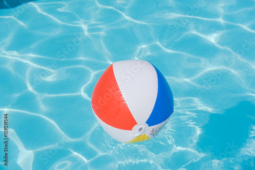 Swimming Pool Beach Ball Background In Bright Multicolor Beach Ball Floating In Blue Swimming Pool Colorful Float Refreshing Pool