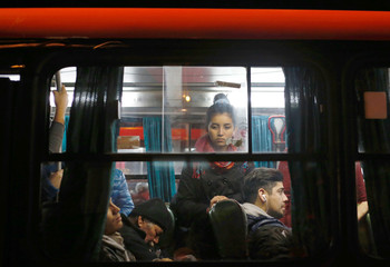 People are seen aboard a bus at rush hour during the afternoon in Valparaiso, Chile