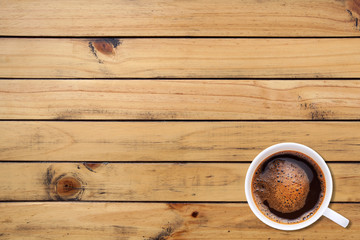A cup of coffee on wood texture background