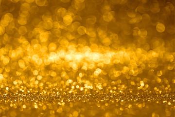 Background of gold glitter in bokeh