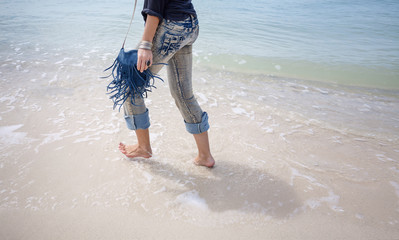 close up of woman feet. barefooted woman walking by the shore line