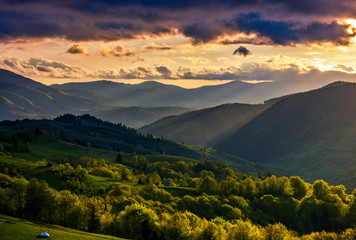 mountain rural area in springtime at cloudy sunset