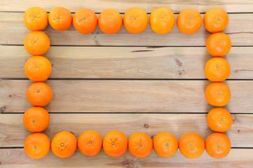 新鮮な蜜柑による四角いフレーム