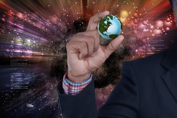businessman hand showing digital planet