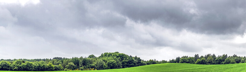 Rural panorama landscape with dark clouds