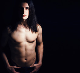 handsome young man with long hair naked torso