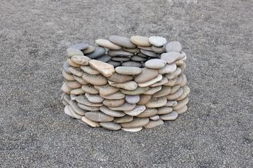 stone well on the sand beach