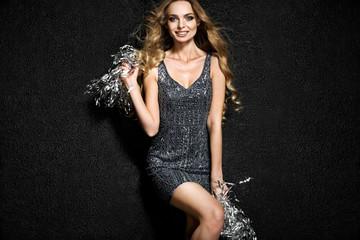 Beautiful blonde woman on black background