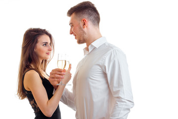man with girl drink champagne in the Studio