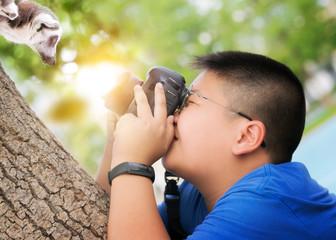 Asian kid take a photo animal