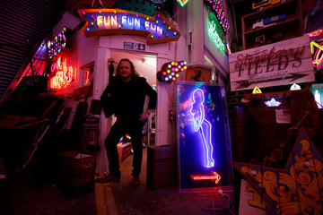 Third generation neon light artist Marcus Bracey poses for a portrait picture in God's Own Junkyard gallery and cafe where he exhibits and sells his work in London