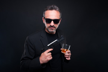 Confident gangster man with a glass of whisky