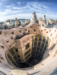 Rooftop of Case Mila - house designed by Antoni Gaudi in Barcelona, Spain