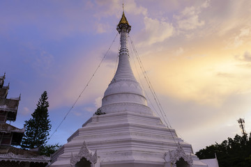 The white Buddhist  pagoda with the twilight scene at the north of Thailand.Most famous landmark for Meahongson province.