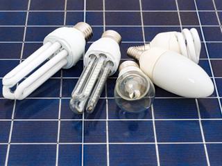 Various energy saving bulbs set on a solar panel