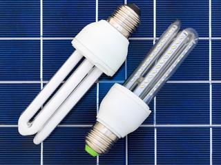 LED and CFL bulbs set on a solar panel
