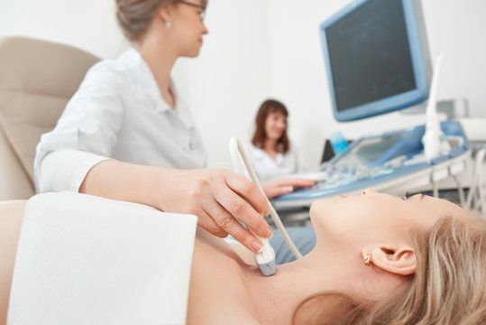 Close up shot of a young woman getting her neck examined by doctor using ultrasound scanner at the modern clinic medicine healthcare professional survey expert doctors concept.