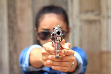 The woman at the shooting range shot from a revolvers