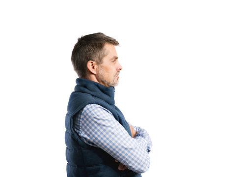 Mature hipster man in shirt and winter vest. Studio shot, isolat
