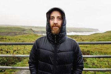 Mid adult man wearing winter coat, portrait