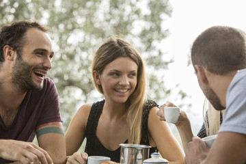 Four friends having fun at breakfast table