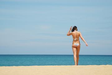 lady wear bikinis walk to the beach