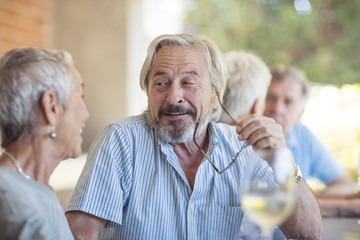 Portrait of senior man listening senior woman