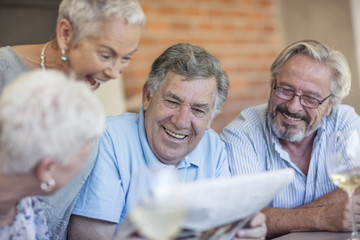 Portrait of smiling senior man having fun with his friends