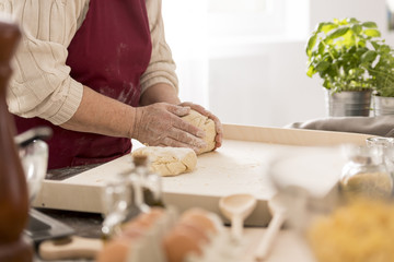 Senior woman preparing fresh pasta