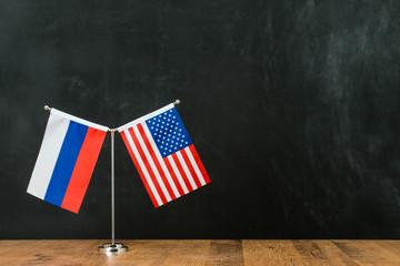 American and Russian flag on flagpole