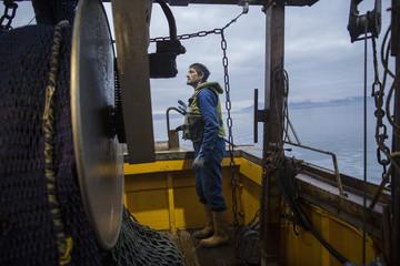 Fisherman preparing trawler