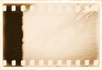 Vintage sepia film strip frame. Plaster textured.
