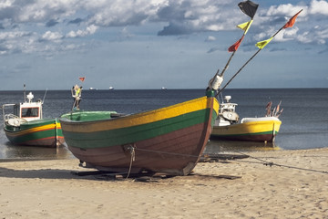 Three fisherman boats at sunny day on the beach