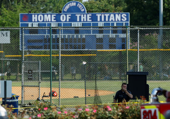 Police investigate a shooting scene after a gunman opened fire on Republican members of Congress during a baseball practice in Alexandria, Virginia