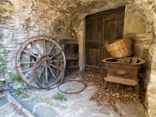 Rustic, rural remains. Cartwheels and old stove.